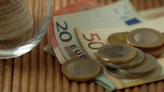 business and financial concept, rack focusing footage of european union and turkish currency banknote and coin lay on the wooden plank. - european union coin stock videos & royalty-free footage