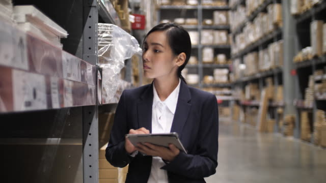 business asian women using on digital tablet at warehouse. checking ordering in stock - organisation stock videos & royalty-free footage