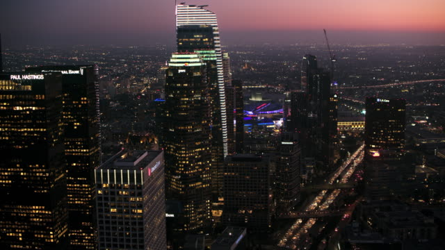 aerial business buildings of the downtown la at night - night stock videos & royalty-free footage