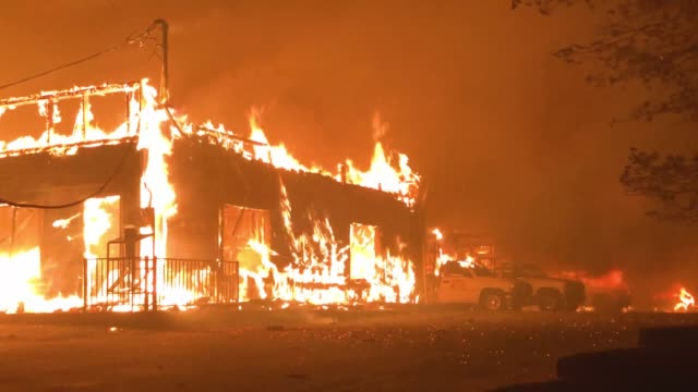 a business burns as the camp fire moves through the area on november 8 2018 in paradise california fueled by high winds and low humidity the rapidly... - camp fire stock videos & royalty-free footage