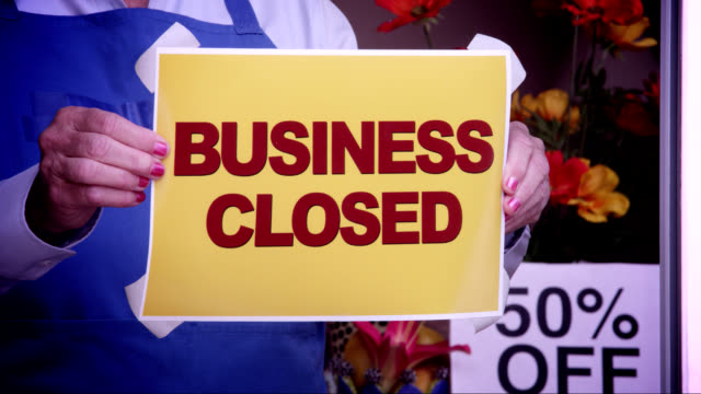 business closed window sign - unemployment stock videos and b-roll footage