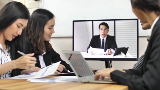 business colleagues attending a video call in conference room - formal businesswear stock videos & royalty-free footage