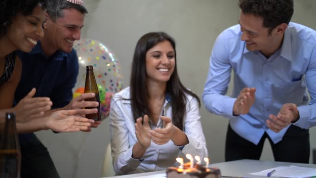 business colleagues celebrating birthday party at work - pardo brazilian stock videos & royalty-free footage