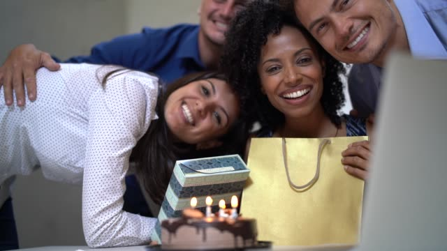 business colleagues celebrating birthday party at work - colleague hug stock videos & royalty-free footage