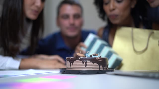 business colleagues celebrating birthday party at work - 30 39 years stock videos & royalty-free footage