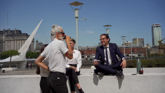 business colleagues enjoying a coffee break outdoors on a sunny day - yerba mate stock videos & royalty-free footage