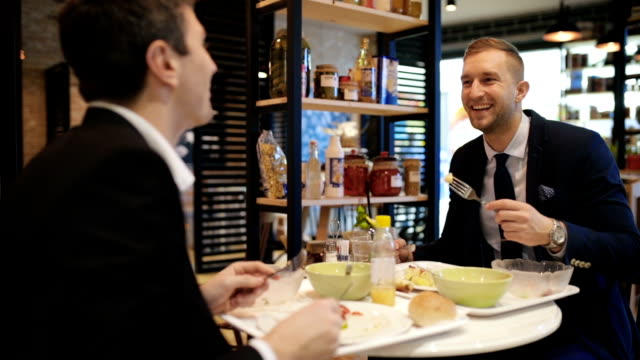 business colleagues having lunch, handheld shot - lunch stock videos & royalty-free footage
