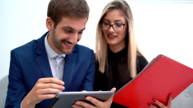 business colleagues look thoughtful whilst discussing a new project at office - employee engagement stock videos & royalty-free footage