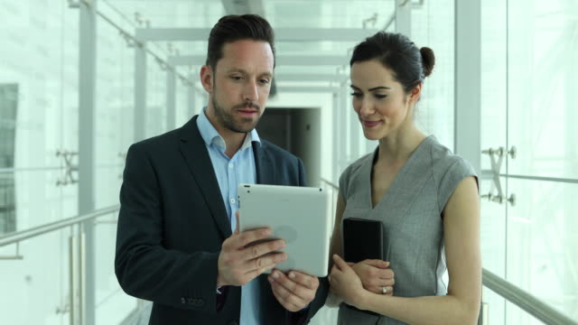Business colleagues looking at digital tablet together