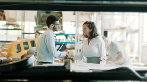 stockvideo's en b-roll-footage met collega's handen schudden in fabriek - factory