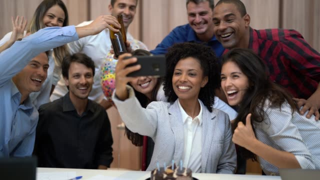business colleagues taking a selfie at birthday party at work - anniversary stock videos & royalty-free footage