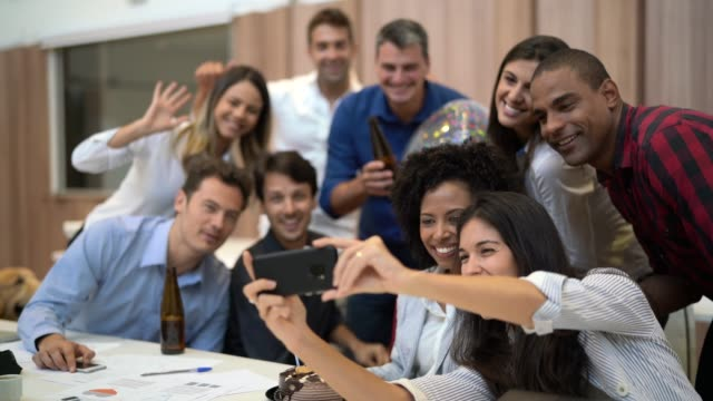 business colleagues taking a selfie at birthday party at work - fun stock videos & royalty-free footage