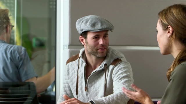 business colleagues talking in office - schiebermütze stock-videos und b-roll-filmmaterial