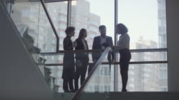 Business Colleagues Talking on Staircase Landing