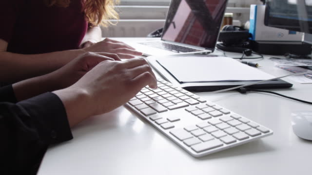 business colleagues working together at desk in office - unrecognisable person stock videos & royalty-free footage