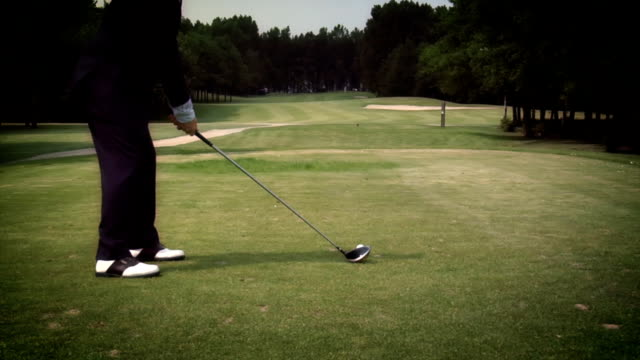business concept - golf in a suit - teeing off stock videos & royalty-free footage