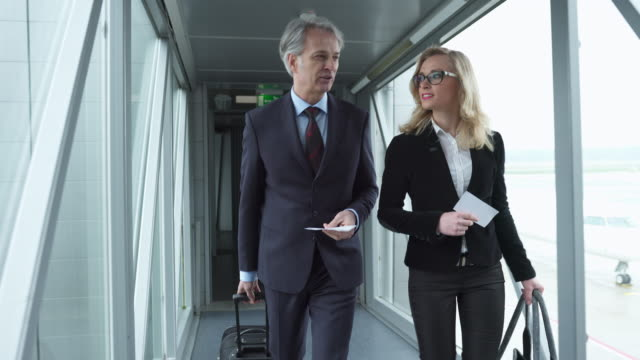 business couple disembarking from a plane - secretary stock videos & royalty-free footage