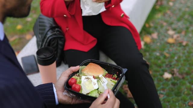 business couple enjoying lunch break outdoors - lunch break stock videos & royalty-free footage