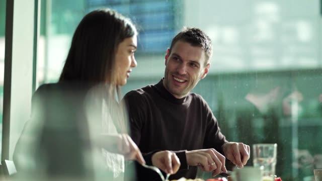 business couple having brunch in restaurant - lunch break stock videos & royalty-free footage