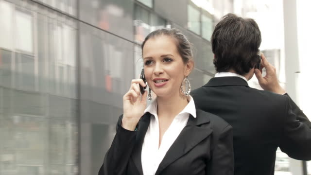 hd slow-motion: business couple on the phone - spinning point of view stock videos & royalty-free footage