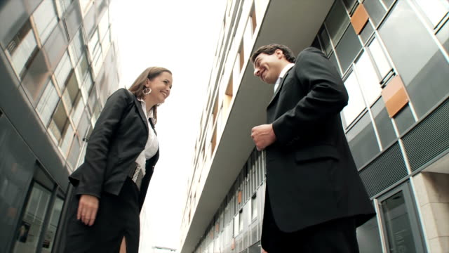 hd dolly: business couple shaking hands - business talk stock videos & royalty-free footage