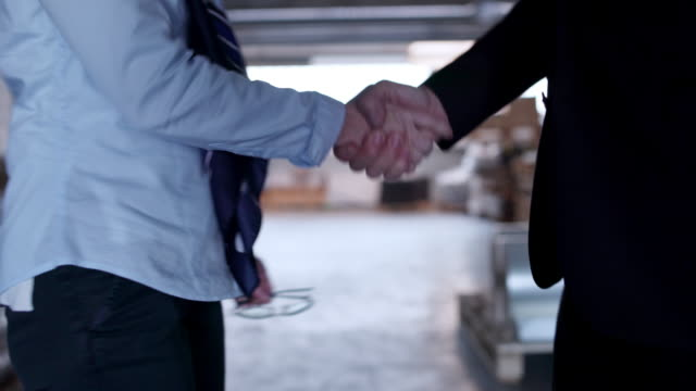 business couple shaking hands - dressing up stock videos & royalty-free footage