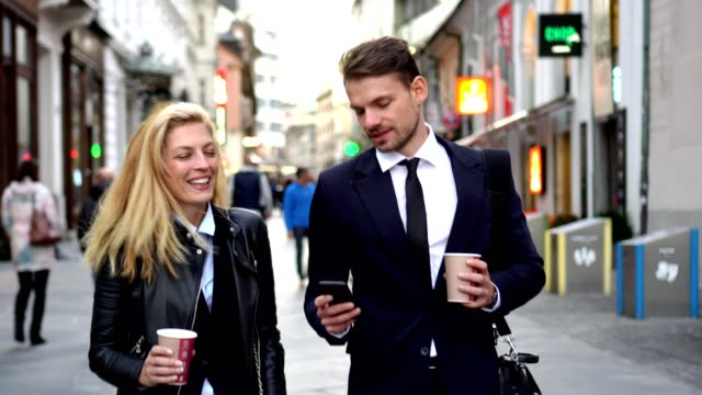business couple walking on the street - on the move stock videos & royalty-free footage