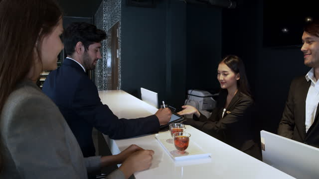 business couple with luggage check in - hotel stock videos & royalty-free footage