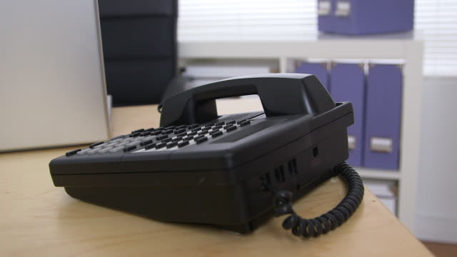 business desk - landline phone stock videos & royalty-free footage