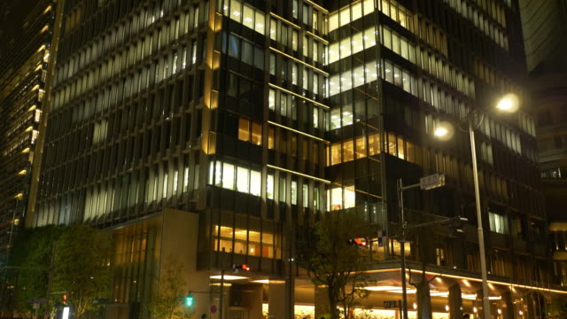 business district in the central tokyo tokyo - tilt up stock videos & royalty-free footage