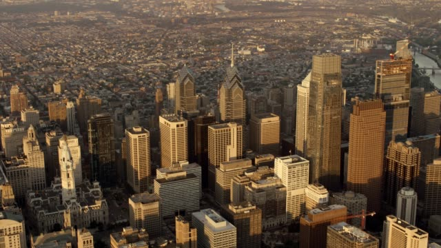 aerial business district of the city of philadelphia, pa at sunrise - center city philadelphia stock videos and b-roll footage