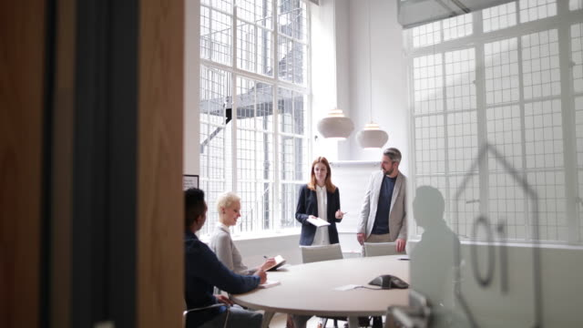 business executives leading a brainstorm meeting - office doorway stock videos & royalty-free footage
