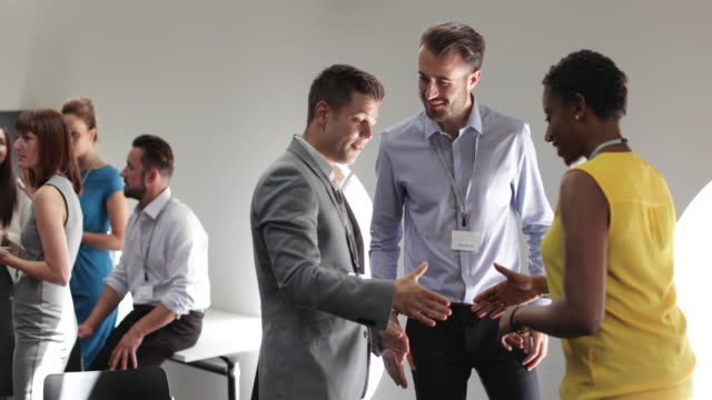 business executives shaking hands at a networking event - meet and greet stock videos and b-roll footage