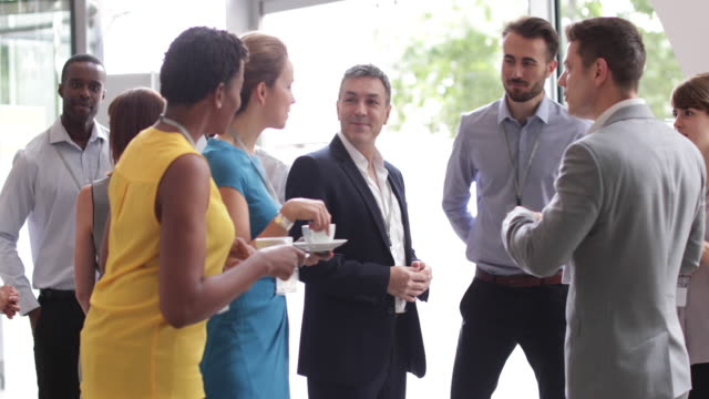 business executives shaking hands at a networking event - business relationship stock videos and b-roll footage