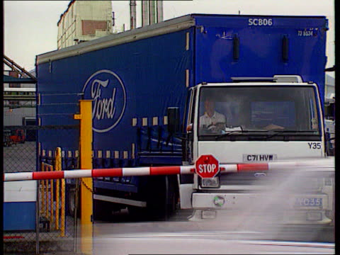 ford job losses lib entrance to factory ford lorry towards car worker opening car's hatch on production line - ford motor company stock videos and b-roll footage