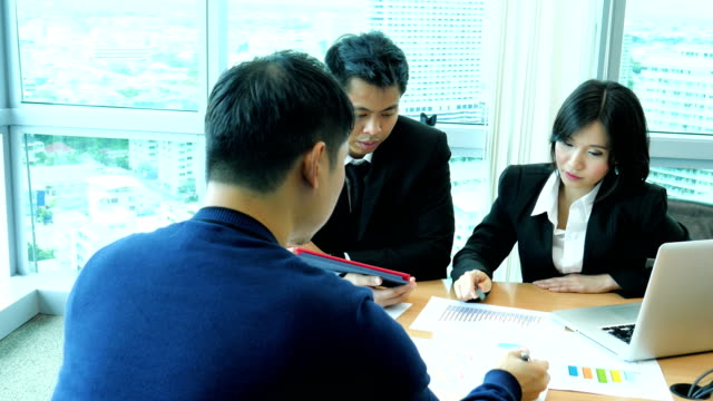 business group having a discussion in a meeting room with financial document - short phrase stock videos and b-roll footage