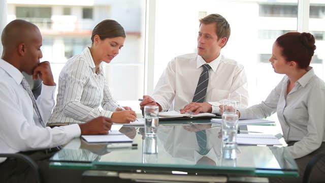 a business group working together - hemd und krawatte stock-videos und b-roll-filmmaterial