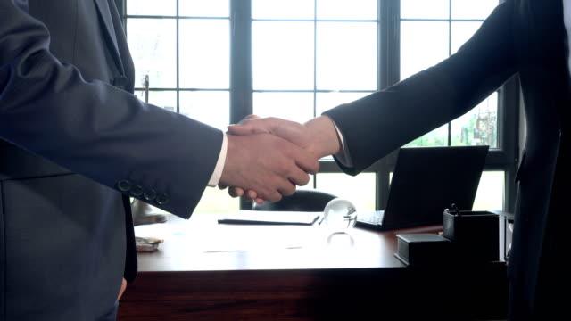 business handshake agreement - leadership stock videos & royalty-free footage