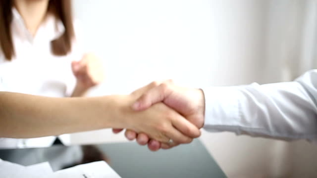 business handshake in the office - selling stock videos & royalty-free footage