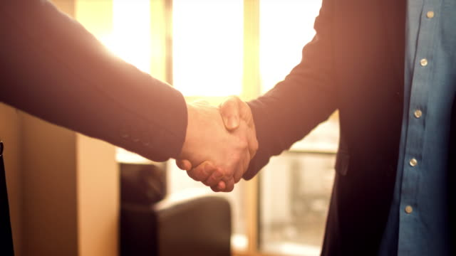 business handshake of two men - close to stock videos & royalty-free footage