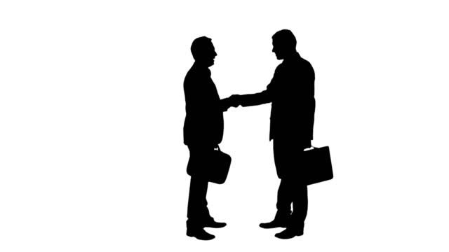 di affari handshake - in silhouette video stock e b–roll