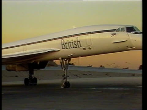 shares; usa, new york airport jfk ba concorde taxiis on runway r-l cms nose of concorde as it turns on tarmac john harvey-jones along through airport... - john f kennedy airport stock videos & royalty-free footage