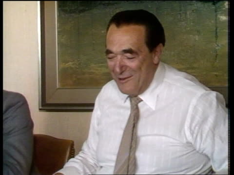 insider dealing int robert maxwell sitting in meeting maxwell owner of firm who applied for advice from morgan grenfell on takeover bid for ae ms as... - robert maxwell stock videos and b-roll footage
