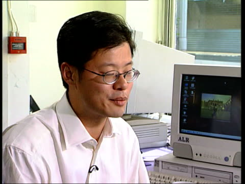 Jerry Yang Interview CS Coffee being poured Yang working on computer in internet cafe Cs Hands tapping on keyboard TMS Chocolate powder dusted over...