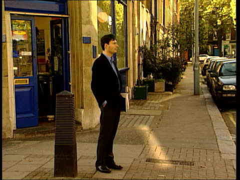 Jerry Yang Interview ITN ENGLAND London Rugman standing in street as waiting to meet Jerry Yang GV Taxi carrying Jerry Yang along past as arriving MS...