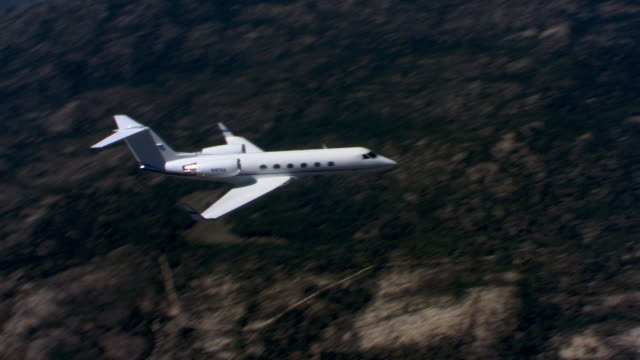 business jet encountered over rugged terrain - private jet stock videos & royalty-free footage