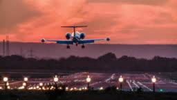 Business Jet landing on airport runway at dusk