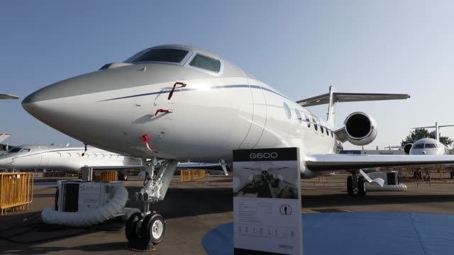 a g600 business jet manufactured by gulfstream aerospace corp a unit of general dynamics corp stands on display at the singapore airshow held at the... - dynamics stock videos and b-roll footage