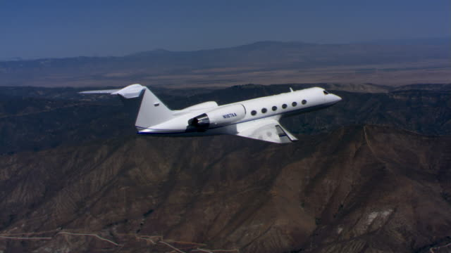 business jet over barren hills - artbeats stock videos & royalty-free footage