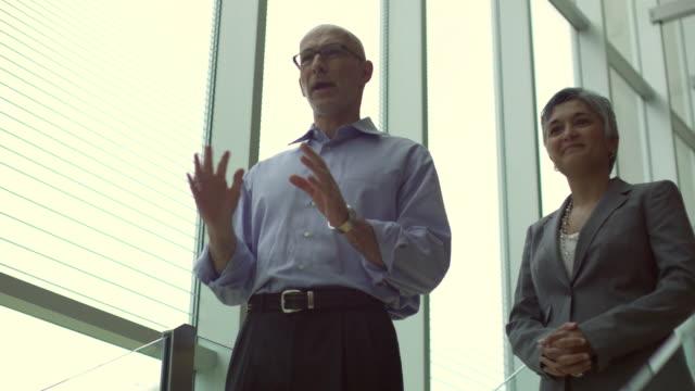 ms la business leaders talking on steps / south orange, new jersey, usa - orange new jersey stock videos & royalty-free footage